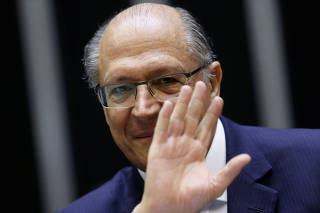 Brazilian Social Democracy Party (PSDB) presidential election pre-candidate, former Sao Paulo Governor Geraldo Alckmin, waves during a Session at the National Congress in Brasilia