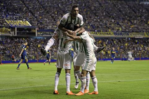 Brazil's Palmeiras forward Keno celebrates with teammates after scoring a goal against Argentina's Boca Juniors during the Copa Libertadores 2018 group H football match at the