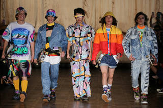 Models present creations from the Amapo collection during the Sao Paulo Fashion Week