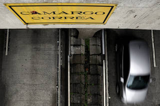 A cars passes through a tunnel built by Camargo Correa, a privately-held Brazilian construction conglomerate, in Sao Paulo
