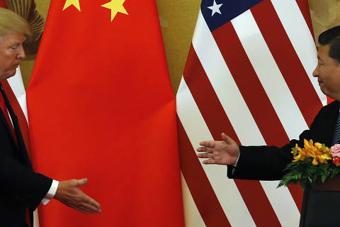 In this Nov. 9, 2017, photo, U.S. President Donald Trump, left, and Chinese President Xi Jinping prepare to shake their hands after a joint press conference at the Great Hall of the People in Beijing. The brewing China-U.S. trade conflict features two leaders who?ve expressed friendship but are equally determined to pursue their nation's interests and their own political agendas. But while Trump faces continuing churn in his administration and a tough challenge in midterm congressional elections, Xi leads an outwardly stable authoritarian regime. Xi recently succeeded in pushing through a constitutional reform allowing him to rule for as long as he wishes while facing no serious electoral challenge. (AP Photo/Andy Wong) ORG XMIT: XAW204