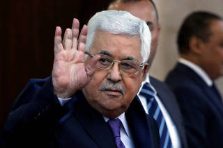 Palestinian President Mahmoud Abbas waves in Ramallah, in the occupied West Bank