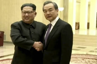 Kim Jong Un, Wang Yi