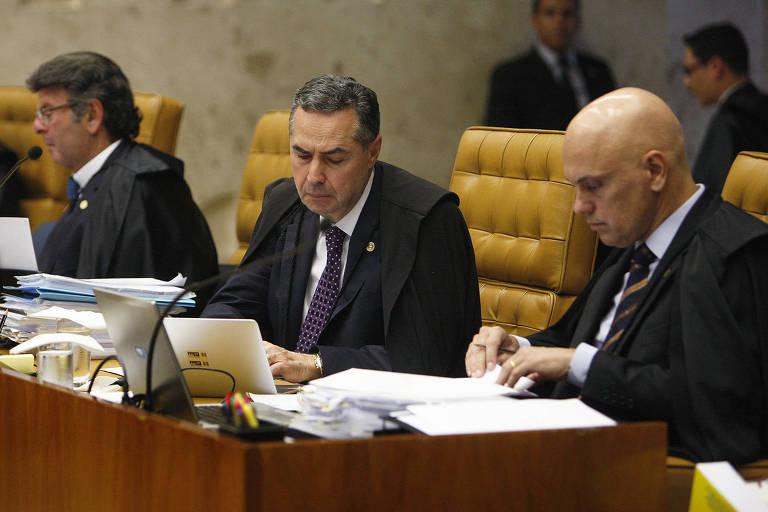 Ministro do Supremo Tribunal Federal Luís Roberto Barroso (centro), relator da ação sobre foro especial
