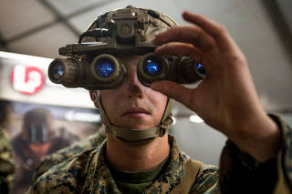 U.S.M.C. Lance Cpl. Skyler Stevens uses new night optics technology at Marine Corps Base Camp Pendleton