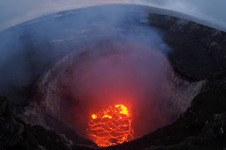 Kilauea volcano's summit lava lake shows a significant drop of roughly 220 metres below the crater rim in Hawaiiii