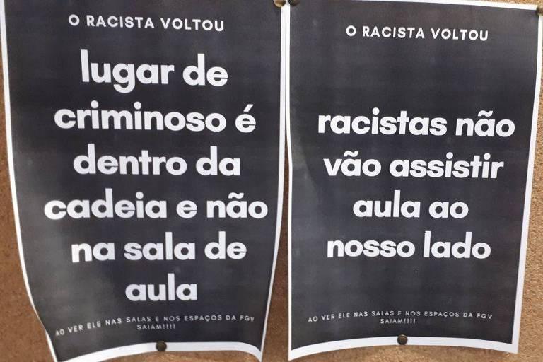 Cartaz com os dizeres: o racista voltou. Lugar de criminoso é dentro da cadeia e não na sala de aula; Racistas não vão assistir aula do nosso lado
