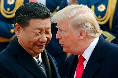 FILE - In this Nov. 9, 2017, file photo, U.S. President Donald Trump, right, chats with Chinese President Xi Jinping during a welcome ceremony at the Great Hall of the People in Beijing. The Trump administration has once again declined to brand China a currency manipulator, but it did target that country and five others for special monitoring for what the administration says are practices that are worsening America's trade deficit. (AP Photo/Andy Wong, File) ORG XMIT: NYSH202