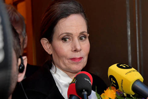 FILE PHOTO: The Swedish Academy's Permanent Secretary Sara Danius talks to the media as she leaves after a meeting at the Swedish Academy in Stockholm, Sweden April 12, 2018.  TT News Agency/Jonas Ekstromer/via REUTERS/File Photo   ATTENTION EDITORS - THIS IMAGE WAS PROVIDED BY A THIRD PARTY. SWEDEN OUT. NO COMMERCIAL OR EDITORIAL SALES IN SWEDEN ORG XMIT: HFS-INK01