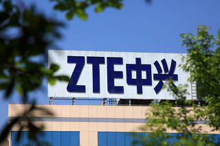 FILE PHOTO: The logo of China's ZTE Corp is seen on a building in Nanjing
