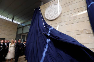 U.S. Treasury Secretary Steven Mnuchin unveils the seal for the new U.S. embassy, as he stands next to Senior White House Adviser Ivanka Trump during the dedication ceremony of the new U.S. embassy in Jerusalem
