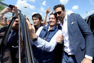 Juventus goalkeeper Gianluigi Buffon poses for pictures with fans in front of Allianz stadium after a news conference in Turin