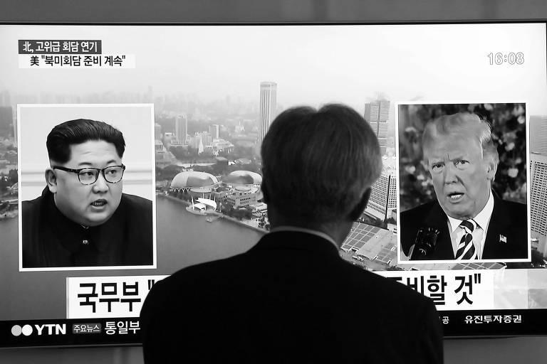 Em Seul, na Coreia do Sul, televisão exibe imagem do ditador norte-coreano, Kim Jong-un, e do presidente dos EUA, Donald Trump
