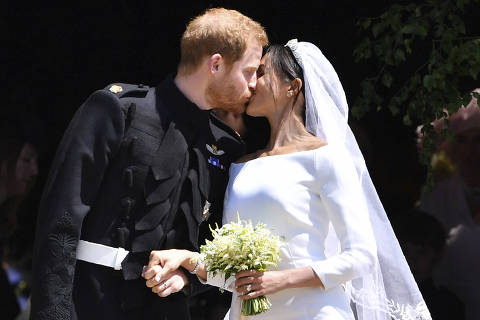 Britain's Prince Harry and his wife Meghan Markle kiss after their wedding ceremony at St. George's Chapel in Windsor Castle in Windsor, near London, England, Saturday, May 19, 2018. (Ben Stansall/pool photo via AP) ORG XMIT: TH106