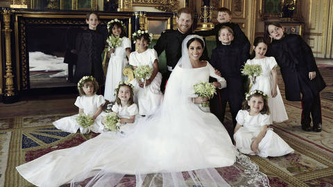 In this photo released by Kensington Palace on Monday May 21, 2018, shows an official wedding photo of Britain's Prince Harry and Meghan Markle, center, in Windsor Castle, Windsor, England, Saturday May 19, 2018. Others in photo from left, back row, Brian Mulroney, Remi Litt, Rylan Litt, Jasper Dyer, Prince George, Ivy Mulroney, John Mulroney; front row, Zalie Warren, Princess Charlotte, Florence van Cutsem. (Alexi Lubomirski/Kensington Palace via AP) ORG XMIT: LON817