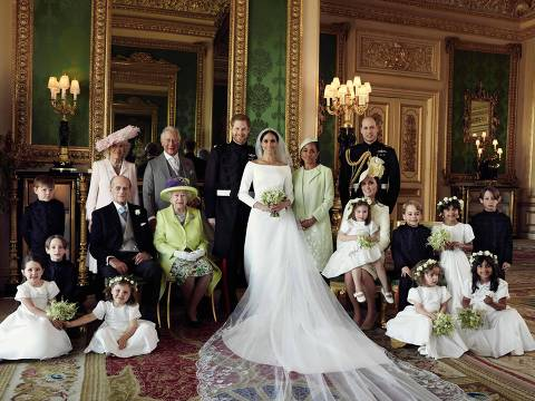 """TOPSHOT - CORRECTION - A picture released by Kensington Palace on behalf of The Duke and Duchess of Sussex on May 21, 2018 shows Britain's Prince Harry, Duke of Sussex, (CL) and his wife Meghan, Duchess of Sussex, (CR) posing for an official wedding photograph with (L-R back row) Britain's Camilla, Duchess of Cornwall, Britain's Prince Charles, Prince of Wales, Doria Ragland, the Duchess of Sussex's mother, Britain's Prince William, Duke of Cambridge, (middle row L-R): Master Jasper Dyer, Britain's Prince Philip, Duke of Edinburgh, Britain's Queen Elizabeth II, Britain's Catherine, Duchess of Cambridge, Princess Charlotte of Cambridge, Prince George of Cambridge, Miss Rylan Litt, Master John Mulroney and (front row) Miss Ivy Mulroney, Master Brian Mulroney, Miss Florence van Cutsem, Miss Zalie Warren and Miss Remi Litt in the Green Drawing Room, Windsor Castle, in Windsor on May 19, 2018.  / AFP PHOTO / KENSINGTON PALACE / Alexi Lubomirski / RESTRICTED TO EDITORIAL USE - MANDATORY CREDIT """"AFP PHOTO / THE DUKE AND DUCHESS OF SUSSEX / ALEXI LUBOMIRSKI """" - NO MARKETING NO ADVERTISING CAMPAIGNS - NO COMMERCIAL USE - NO SALES - RESTRICTED TO SUBSCRIPTION USE - NO USE IN SOUVENIRS OR MEMORABILIA - NO CROPPING, ENHANCING OR DIGITAL MODIFICATION - NOT TO BE USED AFTER DECEMBER 31, 2018 - DISTRIBUTED AS A SERVICE TO CLIENTS   / """"The erroneous mention[s] appearing in the metadata of this photo by Alexi Lubomirski has been modified in AFP systems in the following manner: [A picture released by Kensington Palace on behalf of The Duke and Duchess of Sussex on May 21, 2018 shows Britain's Prince Harry, Duke of Sussex, (CL) and his wife Meghan, Duchess of Sussex, (CR) posing for an official wedding photograph with (L-R back row) Britain's Camilla, Duchess of Cornwall, Britain's Prince Charles, Prince of Wales, Doria Ragland, the Duchess of Sussex's mother, Britain's Prince William, Duke of Cambridge, (middle row L-R): Master Jasper Dyer, Britain's Prince Philip, Duke of Edinburgh,"""