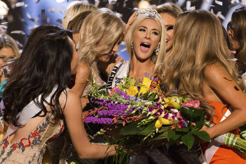 In this photo provided by The Miss Universe Organization, Sarah Rose Summers, Miss Nebraska USA 2018, is crowned Miss USA and congratulated by fellow contestants at the conclusion of the event, Monday, May 21, 2018, in Shreveport, La. (Brittany Elizabeth Strickland/The Miss Universe Organization via AP) ORG XMIT: NYSB201