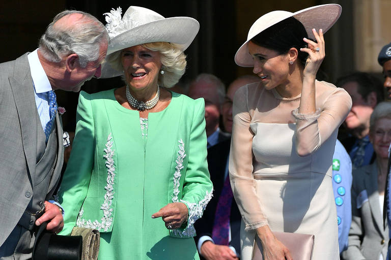 Meghan Markle (D), duquesa de Sussex, ao lado dos sogros, o príncipe Charles e a mulher, Camila Shand, duquesa de Cornualha, na festa em comemoração aos 70 anos do príncipe Charles, no Palácio de Buckingham