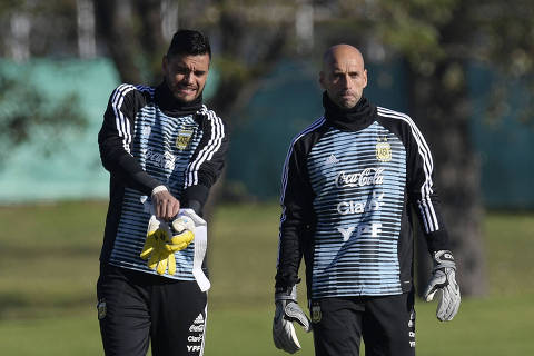 Argentina's national team goalkeepers Sergio Romero (L) and Willy Caballero, arrive to a training session in Ezeiza, Buenos Aires on May 22, 2018. 