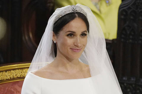 Meghan Markle smiles during her wedding ceremony to Britain's Prince Harry at St. George's Chapel in Windsor Castle in Windsor, near London, England, Saturday, May 19, 2018. (Jonathan Brady/pool photo via AP) ORG XMIT: RWW189