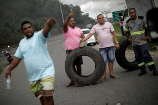 Truck owners block the BR-324 highway during a protest against high diesel prices in Simoes Filho near Salvador