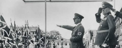Adolf Hitler reviews troops, Gen von Brauschtisch next to him.