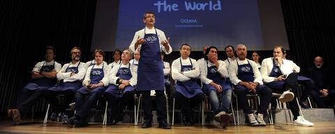 Spanish chef Andoni Luis Aduriz (C) speaks as he participates with other international top chefs in a conference supporting Oceana's worldwide campaign