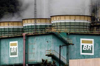Smoke billows from tanks of Brazil's state-run Petrobras oil company at Presidente Bernardes Refinery in Cubatao