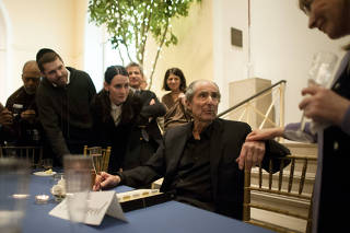 Author Philip Roth greets friends and fans during his 80th birthday party at the Newark Museum in Newark, N.J.
