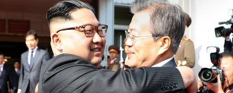 TOPSHOT - This picture taken on May 26, 2018 and released by the Blue House via Dong-A Ilbo shows South Korea's President Moon Jae-in (R) hugging North Korea's leader Kim Jong Un after their second summit at the north side of the truce village of Panmunjom in the Demilitarized Zone (DMZ).