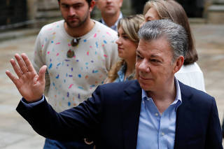 Colombia's President Juan Manuel Santos speaks to the news media after casting his vote at a polling station in Bogota