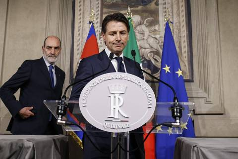 Italian Premier-Designate Giuseppe Conte addresses the media after meeting Italian President Sergio Mattarella in Rome, Sunday, May 27, 2018. Conte relinquished a presidential mandate to put together an acceptable Cabinet. (Fabio Frustaci/ANSA via AP) ORG XMIT: XAP107