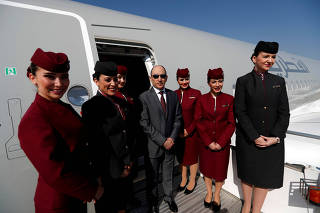 FILE PHOTO: Qatar Airways Chief Executive Officer Akbar al-Baker poses with cabin crew in an Airbus A350-1000 at the Eurasia Airshow in Antalya, Turkey