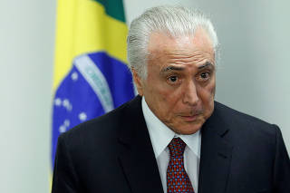 Brazil's President Michel Temer attends a ceremony to approve the goal of the National Biofuels Policy RenovaBio at the Planalto Palace in Brasilia