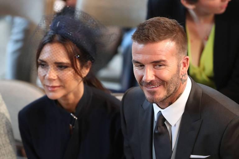 3c83ad524b69ff Victoria e David Beckham durante casamento do príncipe Harry com Meghan  Markle