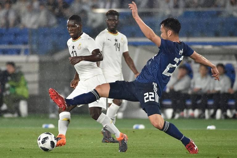 Lance entre Japão e Gana, na cidade de Yokohama, na última partida da seleção japonesa antes do Mundial