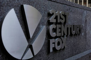 FILE PHOTO: The 21st Century Fox logo is displayed on the side of a building in midtown Manhattan in New York