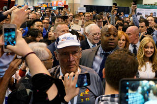 Warren Buffett, CEO of Berkshire Hathaway Inc, walks through the exhibit hall at the company's annual meeting in Omaha