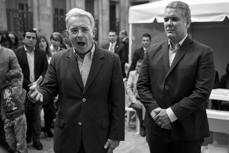 O ex-presidente colombiano Álvaro Uribe e o candidato Iván Duque, favorito para suceder Juan Manuel Santos no comando do país