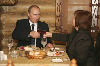 Russia's President Putin toasts with his wife as they visit a restaurant in Moscow after voting