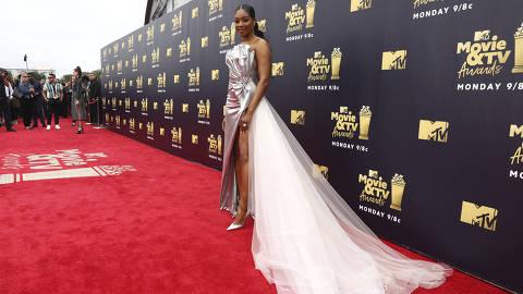 Host Tiffany Haddish arrives at the MTV Movie and TV Awards at the Barker Hangar on Saturday, June 16, 2018, in Santa Monica, Calif. (Photo by Matt Sayles/Invision/AP) ORG XMIT: CADC156