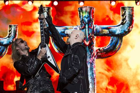 Rob Halford, vocalist of heavy metal band Judas Priest, right and Richie Faulkner, left, perform during the Hell and Heaven music festival in Mexico City, Saturday, May 5, 2018. (AP Photo/Christian Palma) ORG XMIT: MXCP131