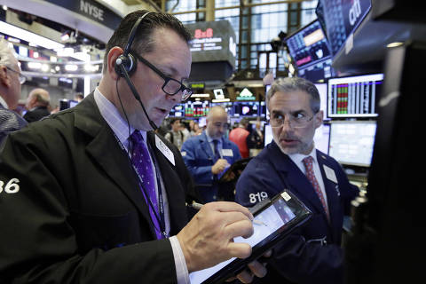 Trader Edward Curran, left, and specialist Anthony Rinaldi work on the floor of the New York Stock Exchange, Tuesday, June 19, 2018. U.S. stock markets are opening sharply lower Tuesday as tensions over trade between the U.S. and China seem closer to a boil. (AP Photo/Richard Drew) ORG XMIT: NYRD108