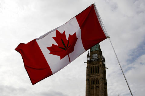 A Canadian flag with a marijuana leaf on it is seen during the annual 4/20 marijuana rally on Parliament Hill in Ottawa, Ontario, Canada, April 20, 2017. REUTERS/Chris Wattie ORG XMIT: TOR346