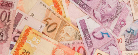 Brazilian Real (Reais) bills distributed on the table as a backround