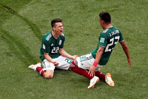 Soccer Football - World Cup - Group F - Germany vs Mexico - Luzhniki Stadium, Moscow, Russia - June 17, 2018   Mexico's Hirving Lozano celebrates scoring their first goal with Jesus Gallardo             REUTERS/Christian Hartmann     TPX IMAGES OF THE DAY ORG XMIT: AI