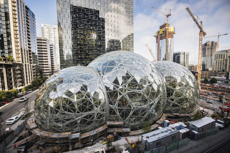 Amazon Tower II rises above the Amazon Biospheres in Seattle.