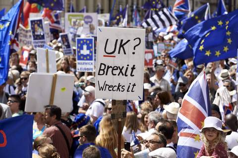 Demonstrators carry banners and flags as they participate in the People's March demanding a People's Vote on the final Brexit deal, in central London on June 23, 2018, the second anniversary of the 2016 referendum.