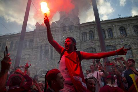 Tunisian soccer fans celebrate in the Nikolskaya street near Red Square during the 2018 soccer World Cup in Rostov Arena in Moscow, Russia, Thursday, June 21, 2018. (AP Photo/Alexander Zemlianichenko) ORG XMIT: XAZ131