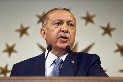 Turkey's President Recep Tayyip Erdogan delivers a statement on national television from his official residence in Istanbul, Sunday, June 24, 2018. Erdogan has claimed victory in critical elections based on unofficial results, securing an executive presidency with sweeping powers. (AP Photo/Lefteris Pitarakis) ORG XMIT: XAF229